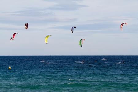 Seaside fun with kites in Spain
