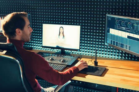 Photo for Confident Man editing video in his Studio. - Royalty Free Image