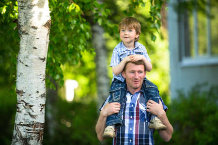 Portrait of father and son outdoors