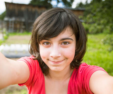 Photo for Teen-girl taking a selfie out in the park. - Royalty Free Image
