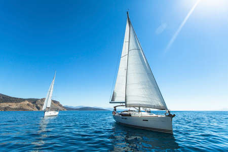 Photo pour Sailing regatta. Luxury yachts. Sailing in the wind through the waves at the Aegean Sea in Greece. - image libre de droit
