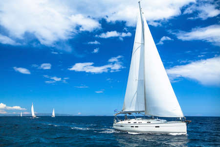Photo for Sailing boat yacht or sail regatta race on blue water Sea. - Royalty Free Image