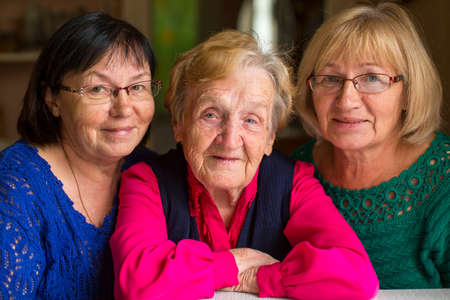 Photo pour Elderly woman with two adult daughters. - image libre de droit