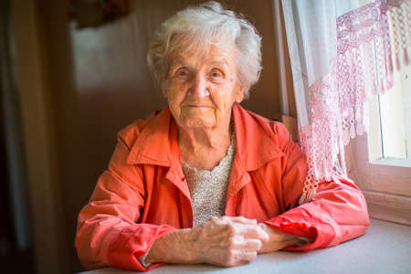 Photo for Portrait of stern elderly women. - Royalty Free Image