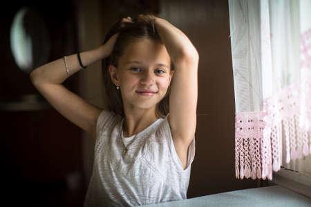 Foto de Portrait of little cute girl posing for the camera. - Imagen libre de derechos