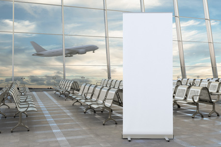Foto de Blank roll up banner stand and airplane on background in airport terminal lounge. Include clipping path around ad poster. 3d render - Imagen libre de derechos