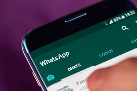 Foto de New york, USA - May 22, 2017: Whatsapp app menu  on modern smartphone macro. Man using whatsapp application - Imagen libre de derechos