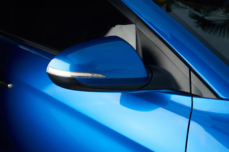 Photo for Side car mirror close-up. Details of blue car - Royalty Free Image