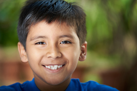 Foto de Close-up portrait of boy smiling with teeth. Hispanic boy headshot - Imagen libre de derechos
