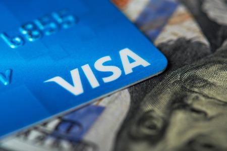 Photo pour New york, USA - August 24, 2017: Macro of visa logo card on dollar bill background - image libre de droit