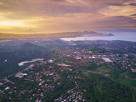 Foto de Cityscape of Managua town aerial view in sunset time. Managua landscape capital of Nicaragua - Imagen libre de derechos