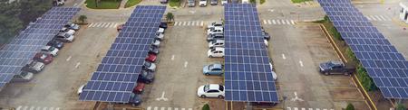 Photo pour Parking lot with solar panel on roof aerial above view - image libre de droit