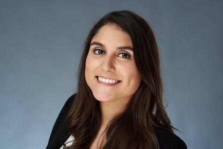 Foto de Business portrait of latina woman isolated on gray studio background - Imagen libre de derechos