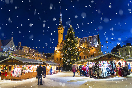Photo for Christmas in Tallinn. Town Hall Square with Christmas Fair - Royalty Free Image