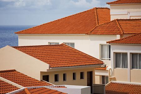 Foto de Fragments of several houses with tiled roof - Imagen libre de derechos
