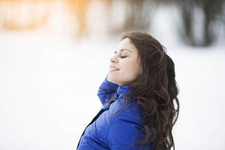 Photo for Happy dark-haired young woman in blue jacket - Royalty Free Image