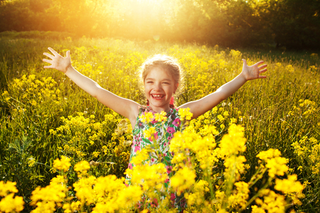 Photo for Happy cheerful little girl among yellow wildflowers - Royalty Free Image