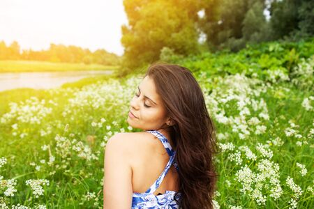 Photo for Beautiful happy girl with closed eyes in the middle of the meadow - Royalty Free Image