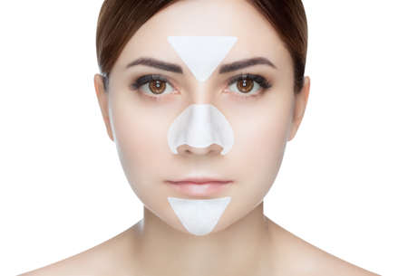 Foto de Portrait of a beautiful girl with a mask from acne on the nose and t-zone. - Imagen libre de derechos