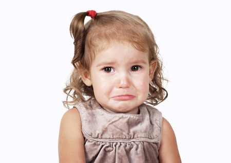 Photo pour Portrait of sad crying baby girl on white - image libre de droit