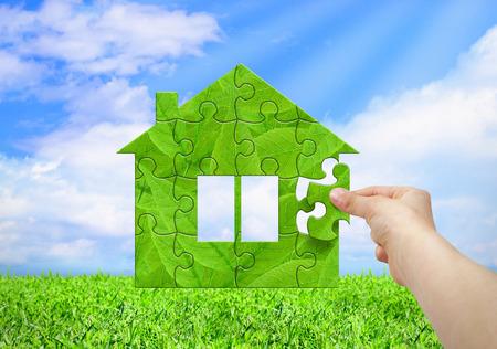 Foto de Eco house concept, hand build house from puzzle - Imagen libre de derechos