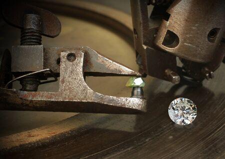 Foto de Faceting diamond, big gem with jewelery cutting equipment. - Imagen libre de derechos