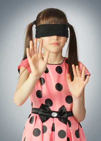 Photo for Child with blindfold, blind concept on grey background - Royalty Free Image