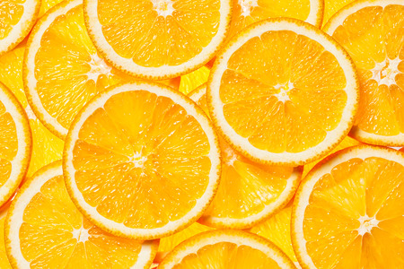 Photo for Colorful orange citrus fruit slices background backlit - Royalty Free Image
