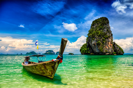 Photo for Long tail boat on tropical beach (Pranang beach) and rock, Krabi, Thailand - Royalty Free Image