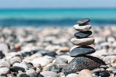 Foto de Zen meditation background -  balanced stones stack close up on sea beach - Imagen libre de derechos
