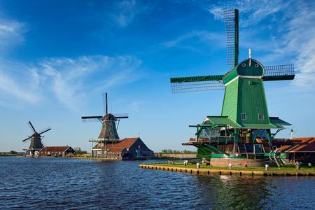 Photo for Windmills at Zaanse Schans in Holland on sunset. Zaandam, Nether - Royalty Free Image
