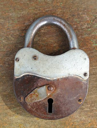 Photo for Old rusty padlock on wooden background - Royalty Free Image