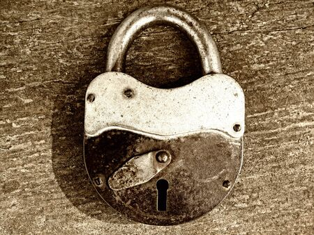 Photo for old padlock on wooden background                                - Royalty Free Image