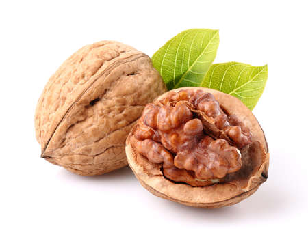 Photo for Walnuts with leaf in closeup - Royalty Free Image