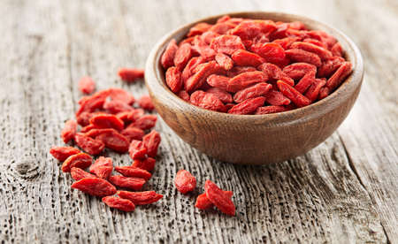 Photo for Goji berries on a wooden board - Royalty Free Image