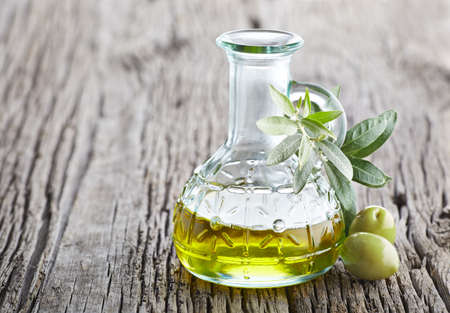Photo for Olive oil on a old wooden board - Royalty Free Image