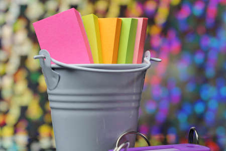 Photo for A container with colorful sticky notes. - Royalty Free Image