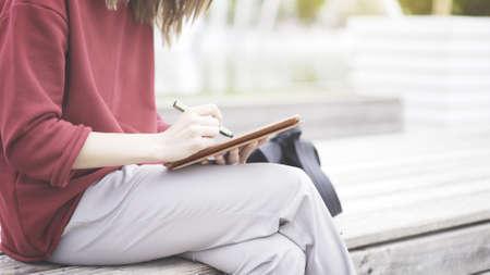 Foto für A closeup of tablet and female hand holding a green pencil writing on a touchscreen - Lizenzfreies Bild