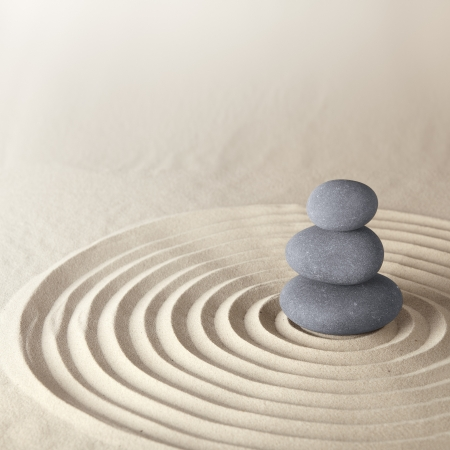 Photo for Japanese zen garden meditation stone for concentration and relaxation sand and rock for harmony and balance in pure simplicity - Royalty Free Image