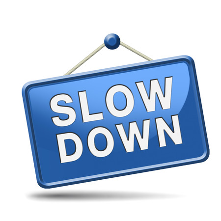 Photo pour Slow down and take it easy and slowly. Blue placard. - image libre de droit