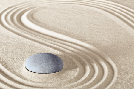 Foto de spa treatment concept japanese zen garden stones tao buddhism conceptual for balance harmony relaxation meditation wellness background harmony and purity stone stack in sand pattern spiritual elements - Imagen libre de derechos