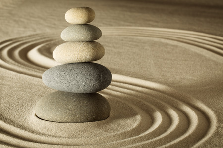 Photo for balance and harmony in zen meditation garden relaxation and simplicity for concentration. Sand and stone form nice lines and pattern - Royalty Free Image