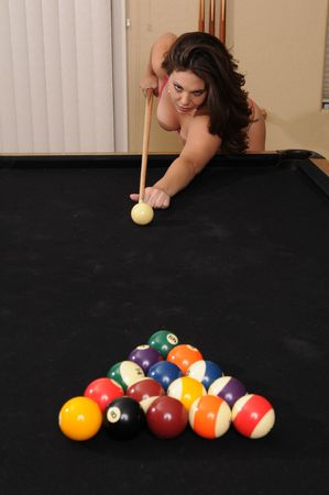 Adorable young brunette at the pool table