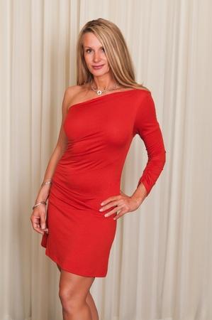Foto per Beautiful mature blonde in a red dress - Immagine Royalty Free