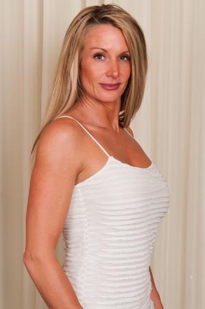 Beautiful mature blonde in a white blouse