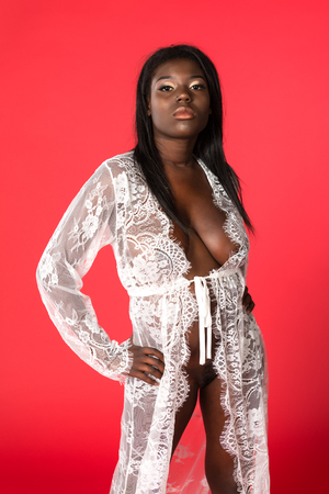 Photo for Shapely Ghanaian woman in a sheer white wrap - Royalty Free Image