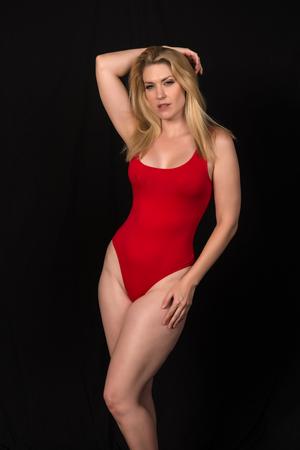 Foto de Beautiful pale blonde in a red one piece swimsuit - Imagen libre de derechos