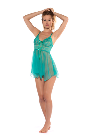 Photo for Tall slender blonde in a teal nightgown - Royalty Free Image