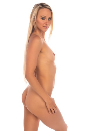 Photo pour Beautiful slender tanned blonde standing nude on white - image libre de droit