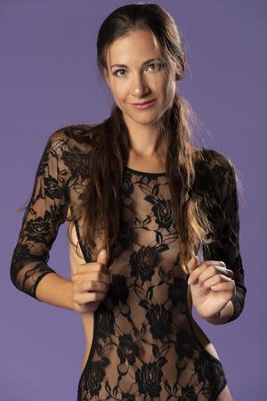 Foto de Beautiful tall brunette in a sheer black lace bodysuit - Imagen libre de derechos